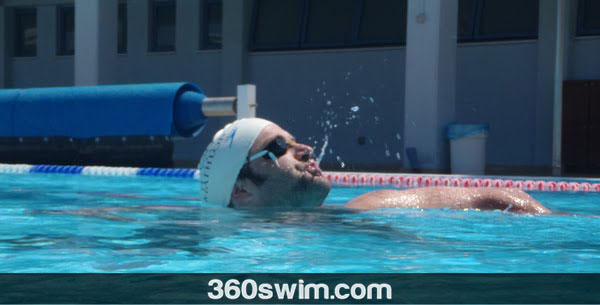 Put goggle strap under your swimming cap