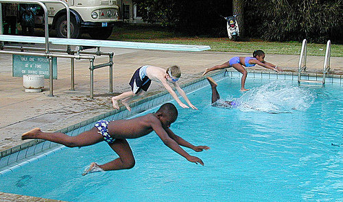 Kids diving belly first by IITA Image Library